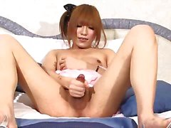 Asian tranny wanking cock