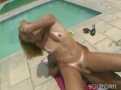 Shemale and girl mutual fuck by a pool