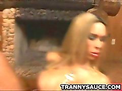 Blonde shemale babe Dartilly tugging on her cock