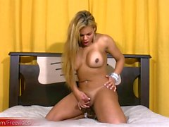 Blonde Latina tranny strokes massive tits and decent shecock