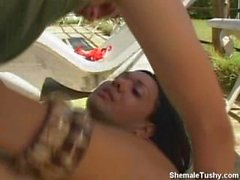 tranny and guy go hard by the pool