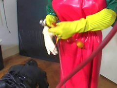 Bizarre rubber enema servant 2 of 5