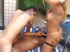 Taking turns with a tgirl by the pool