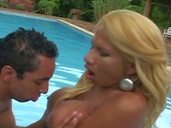 Busty blonde tranny bitch nails his ass by the pool