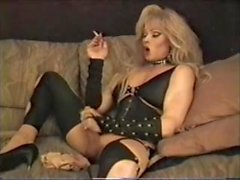 Blonde whore jerks off & smokes