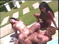 Shemales and girl poolside orgy