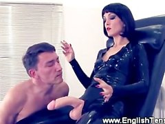 Domina makes gimp suck her strapon