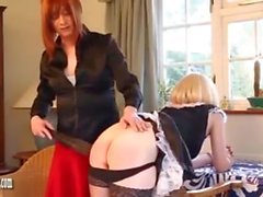 Naughty smoking blonde TGirl maid has tight pert ass spanked