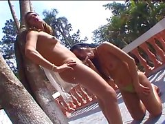 Two shemales get it on by the pool
