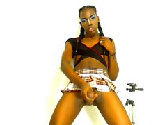 Ebony black tranny shemale jerks off