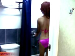 Asian TS in pink bikini strokes girlish cock in the shower