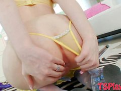 Busty tranny in yellow lingerie analyzed