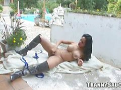 Big tits brunette tranny plays cock solo outdoors