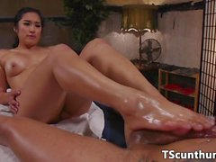TS beauty oiled and rubbed by feetloving babe