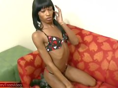 Skinny black tranny fucks a lollipop into her ass