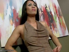 Mature ladyboy in black stocking enjoys stiptease on the bed