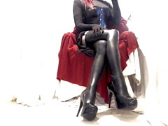 Kinky Crossdresser relaxing in latex stockings and heels 1