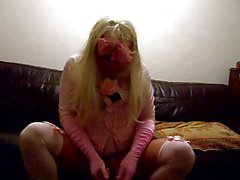 Masked crossdresser wanking on sofa