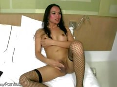 Horny ladyboy in red lingerie inserts beer bottle in her ass