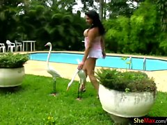 Big ass tranny babe in miniskirt masturbates by the pool