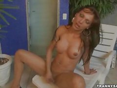 Brazilian tranny jerking off poolside