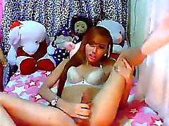 Watch this Hottie Asian tranny enjoy playing her cock right