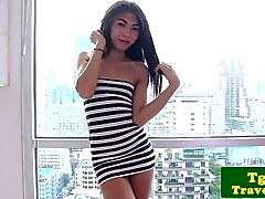 Stripteasing ladyboy pleasures herself