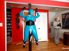 Living Latex Statue in tormented in Bondage