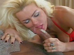 Transsexual blonde fucked by black cock