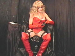 Barbi strokes and pees in red leather.